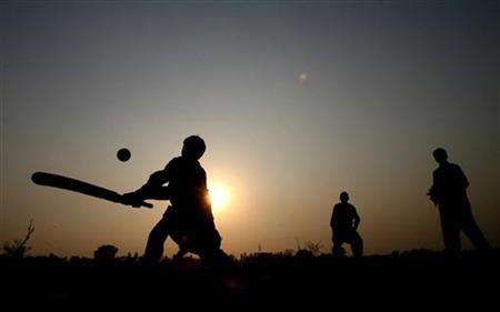 Children play cricket near the Wagah border crossing with India, near Lahore, in Pakistan, where the English cricket team paid a visit, 6 December 2005. REUTERS/ Jason O'Brien.